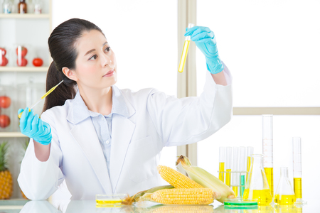 corn biology research from asian female scientist in laboratory