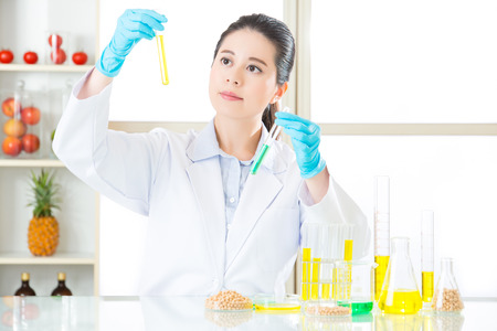 modification: female scientist looking for new genetic modification in laboratory
