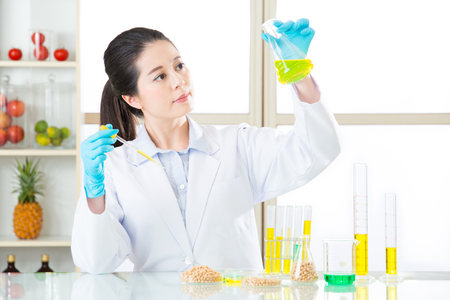 modification: Asian female scientist looking soya for genetic modification research in laboratory Stock Photo