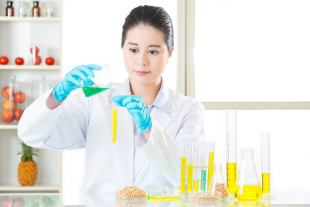 researchers: gmo food chemistry researchers observing indicator color shift research Stock Photo