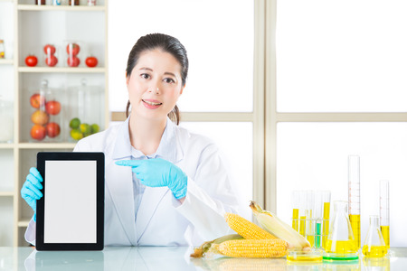 genetic food modification: you will find genetic modification food information on internet by digital tablet