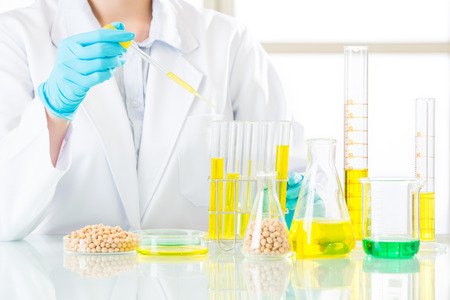 Asian female scientist drop to do genetic modification research in laboratory Stock Photo