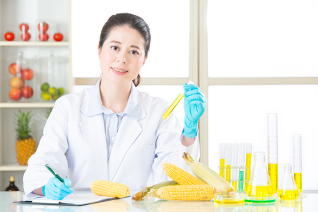 genetically modified crops: scientist Recording genetic modification data from examining in laboratory