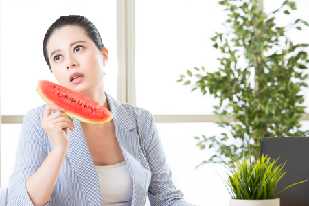 body temperature: if you feel hot in office try watermelon for reduce body temperature Stock Photo