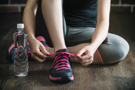 shoestring: knee down with tie sneakers shoestring drink water before fitness exercise, gym sport healthy lifestyle