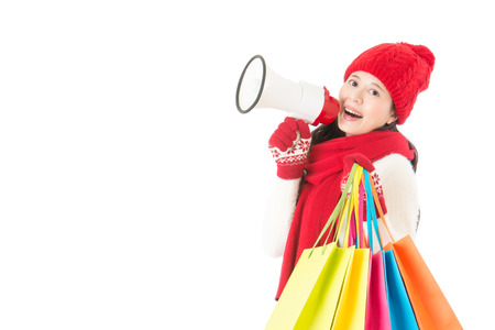 peddle: happy asian woman holding gifts and megaphone with colorful shopping bag. isolated on white background. winter sale concept
