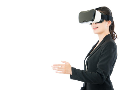 asian business woman handshake by virtual reality. VR headset glasses device. white isolated background Stock Photo