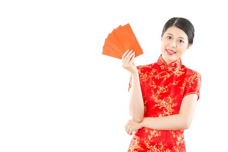 beautiful young asian woman holding red envelope bags happy showing lucky money for chinese new year. isolated on white background. mixed race asian chinese model.