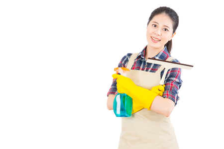 domestic chores: portrait of a Beautiful young asian women doing domestic chores using glass cleaning wiper isolated white background. Beautiful fresh energetic multiracial Chinese Asian female model. Stock Photo