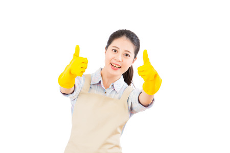 Cleaning woman happy excited showing thumbs up success hand sign smiling joyful isolated on white background. Beautiful fresh energetic multiracial Chinese Asian female model.