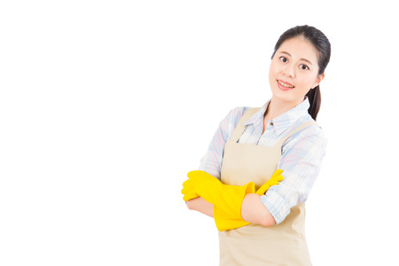 beautiful confidence housewife crossed arm with rubber gloves isolated on white background. Beautiful fresh energetic multiracial Chinese Asian female model. Stock Photo