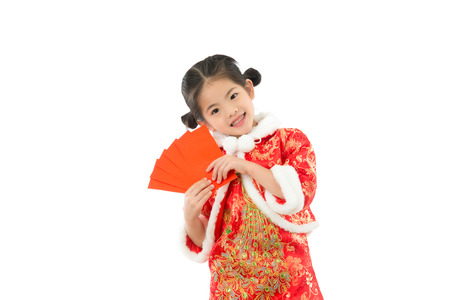 Young Asian girl happy excited with red packet lucky money. isolated on white background. holiday and festival concept.