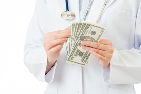 corruptible: asian woman doctor counting money bribery for income. isolated on white background. medical and health concept