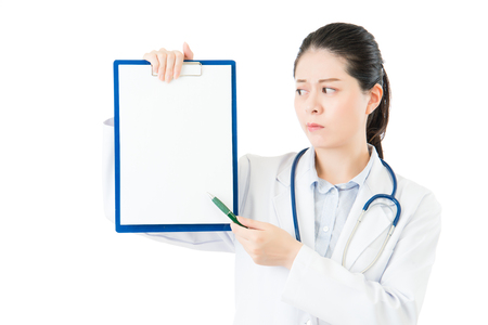 beauty asian doctor pointing showing blank clipboard. isolated on white background. health and medical concept Stock Photo