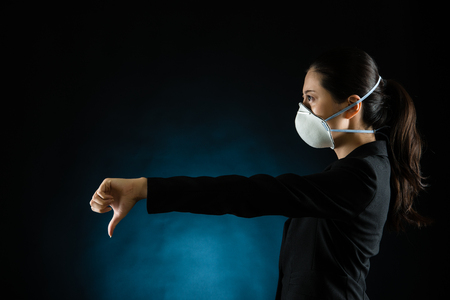 portrait of young business woman wearing a mask. presenting dislike gesture hand. Young multiracial Asian chinese female model