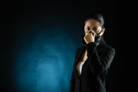 business woman smell stink wearing gas mask, isolated on white background. mixed race asian chinese