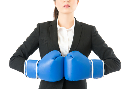 rage businesswoman wearing boxing gloves ready for the competition. Strong business standing intimidating woman boss executive concept. Confident attitude by young mixed race asian model.