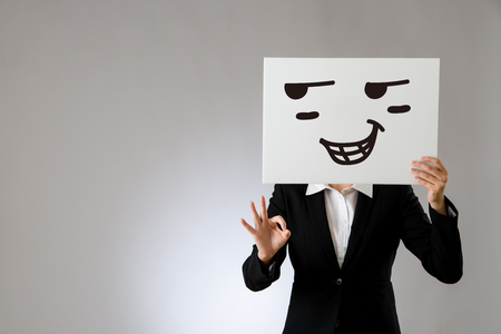 proud face expression drawing on blank white billboard with okay hand gesture. isolated on gray background. business office company concept.