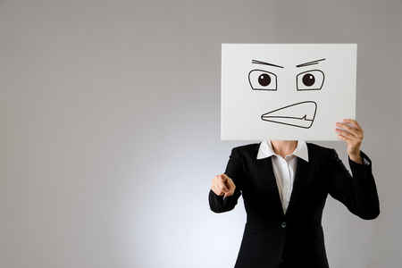 mad office lady feel unhappy face draw on blank poster with criticize pointing finger. isolated on gray background. business office company concept. Stock Photo