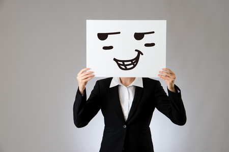 proud woman female boss holding blank white card with positive confident face expression. isolated on gray background. business office company concept.
