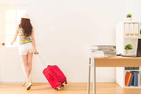 business woman holding suitcase time to get away from work to enjoy long vacation. mixed race asian chinese model. Stock Photo