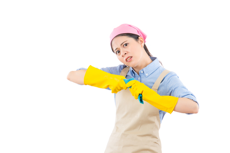 multitasking job mother feel angry insane and showing twist rag release her expression with yellow cleaning gloves, isolated on white background. housework and household concept.