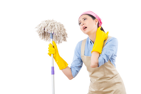 young attractive housewife suffer from neck pain after doing house cleaning feel tired and fatigued. isolated on white background. housework and household health care concept. Stock Photo