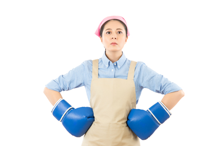 Strong house woman boss concept. Confident attitude young mixed race housewife standing intimidating wearing boxing gloves ready for the competition. isolated on white background. Stock Photo - 78753146
