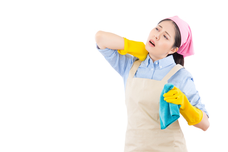 portrait of tired house female massaging her painful neck. isolated on white background. housework and household concept. Stock Photo