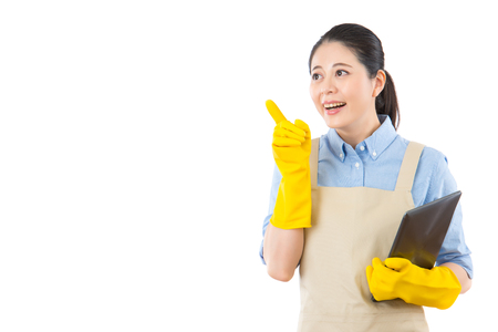 Thinking clean woman looking away smiling pensive. Beautiful cute cleaning girl waring rubber gloves isolated on white background. Multiracial Asian lady.