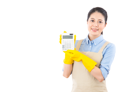 house woman calculate carefully and budget strictly for professional cleaning services spending. isolated on white background. mixed race asian chinese model. Stock Photo