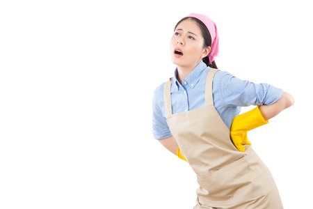young housewife feel tired holding her back in pain and hurt. isolated on white background. housework and household concept.
