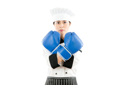 female cooking woman wearing boxing gloves showing cross gestures