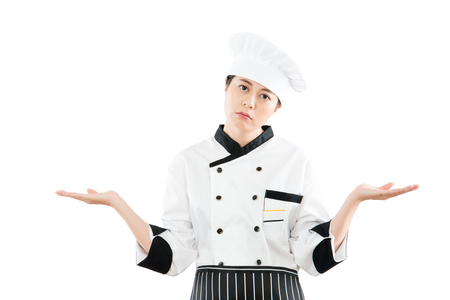 pretty mixed race asian chinese woman chef no idea and dont know how to make best food. isolated on white background. profession and industry job concept.
