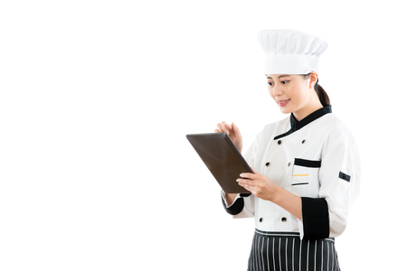 smiling asian woman chef using digital tablet to check menu food order. isolated on white background. profession and industry job concept.