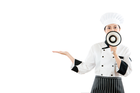 peddle: professional chef open her hand to making the gesture showing display the latest food in copyspace from the restaurant research and development through the megaphone publicity on white background.