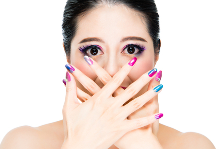 french manicure sexy woman: concept of vogue artist in rainbow style. positive lady model crossing hands blanked laughing mouth and watching on copyspace. Stock Photo