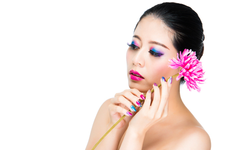 portrait of melancholy asian nail beauty woman showing vogue face style with flower on white wall background copysapce.