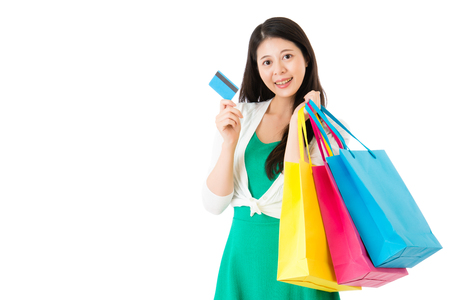 paying: attractive asian woman using credit card paying shopping standing on white background. E-commerce, online shopping concept with copyspace empty area.