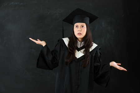 beautiful graduated scholar choose the future road encounter difficulties opened arm and show hands isolated on black background for copyspace text.