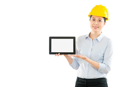 woman foreman showing digital tablet pad computer with blank screen isolated on white copyspace over clean background. profession and industry job concept.