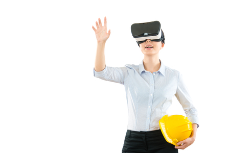 young woman using a virtual reality headset with architecture site work and hand gesture in the air while work on the copyspace at all blank white wall background studio.