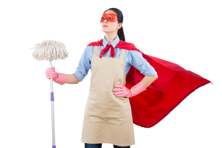 successful confidence mixed race spring cleaning superhero housewife cleaning floor with mop. isolated on white background. housework and household concept. 스톡 콘텐츠