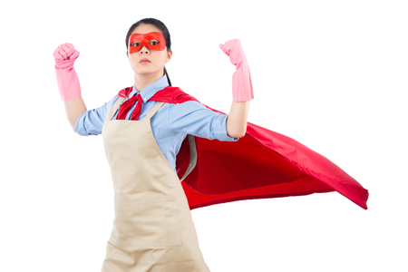 successful confidence housewife superhero showing her strong muscle with her super woman costume for cleaning janitorial services. isolated on white background. housework and household concept.