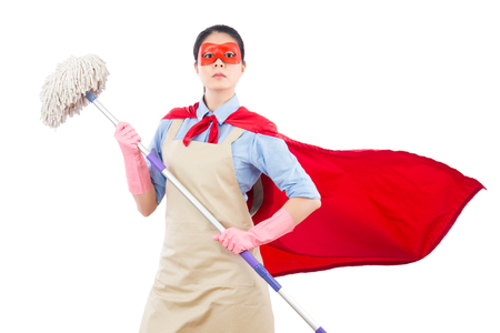 confidence and faith super hero housewife holding mop ready to doing the cleaning job. isolated on white background. housework and household concept.
