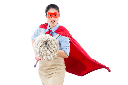super woman: angry mad clean superhero face to camera and holding mop ready to fight doing the cleaning job. isolated on white background. housework and household concept. Stock Photo