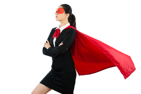 asian young beautiful woman in superhero clothing goggles and cloak costume representing powerful and successful on the white copyspace background confidence standing on the blank wall.