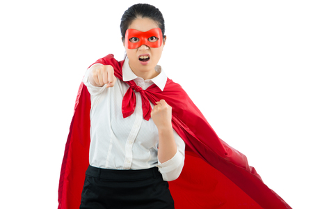 portrait angry mad office superhero positive face to camera and holding fist ready to fight doing the difficult job isolated on white background with copyspace. Stock Photo