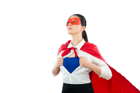 portrait of superwoman hero opening shirt showing powerful and successful looking future on the clean empty copyspace isolated on white wall background. Stock Photo