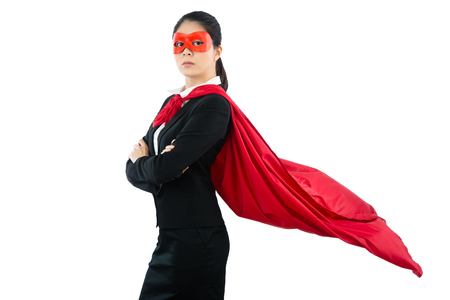 seriously lady in suit arms crossed looking front unhappy standing on copyspace over white background empty area. concept of business professional super hero.
